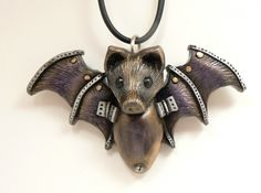 Steampunk jewelry a bat pendant in metallic purple silver and gold with faux screws and hinges on the wings and body Hand made by me entirely from polymer clay as Polymer Clay Pendant, Fimo Clay, Polymer Clay Projects, Polymer Clay Creations, Polymer Clay Crafts, Clay Beads, Polymer Clay Jewelry, Polymer Clay Steampunk, Polymer Clay Halloween