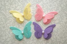 This fun butterfly headband is sweet! Its made with wool blend felt in your color choice of peach, aqua, pink, pale yellow, white and lavender. The butterfly measures 2.25 inches wide with a pearl center on a white skinny elastic band. Also available as a hair clip! Please see my shop page for a size guide and the current processing time. Thank you!  The 411 - *Pick A Color! *Pick A Size! *Dimensions - 2.25 inches wide *Price - $5.75 *Shipping - 1 to 2 weeks before shipping