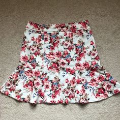 WHBM floral a-line skirt This skirt was only worn 1 time and come from the 2015 spring collection at White House Black Market. It's a-line and looks perfect with the cardigan I also have posted. White House Black Market Skirts A-Line or Full