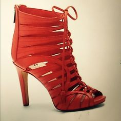 Vince Camuto lace up shoes Gorgeous red lace up Vince Camuto brand new with box never worn size 8 I wear 8- 81/2 they fit perfect  they have a zipper in the back and u can adjust the strap in the front they r 4 inches with a little wedge in front for comfort again they r brand new . Vince Camuto Shoes Ankle Boots & Booties