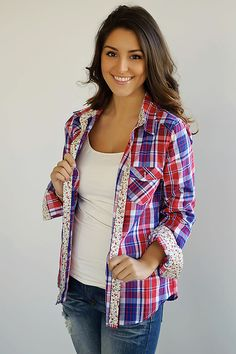 Plaid button down top with floral cuffs and floral detail inside the collar.