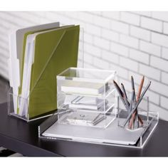 Acrylic desk accessories always look great. The transparent look doesn't create visual clutter.