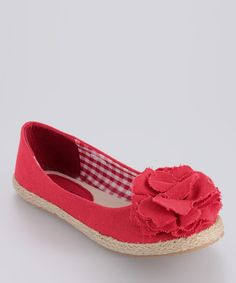 These fun espadrilles feature a fabric blossom atop toes and slip-free soles. When worn with any playground-ready ensemble, they'll emit a fashion-forward vibe.Canvas upperCushioned footbedRubber soleImported
