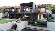 Dieser Haus gewordene Traum aus Stahl und Beton findet sich am Fuße eines Naturschutzgebiets im südafrikanischen Johannesburg. So wenig natürlich es auch aussieht: Die Architekten vom Designstudio Nico van der Meulen haben die großzügige Villa bestmöglich