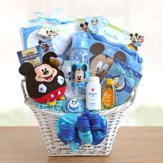"Say ""Welcome Baby"" the Disney way! Welcome the new Baby Boy with a Mickey Mouse gift basket that is sure to make everyone smile. Baby will love the Mickey Mouse"