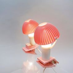 Two beautifull nightlamps, rose, french design of the 70's  http://modernariato.fr/collections/frontpage/products/deux-petites-veilleuses-a-pince-rose