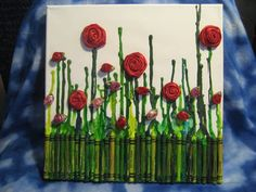 Perfect crayon art! I would so hang this in my craft room! Fabric flowers on an upside-down melted crayon painting turn it into a scene of blooming roses!