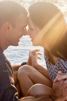 Couple photography at the beach - cute hold hands and lean in together