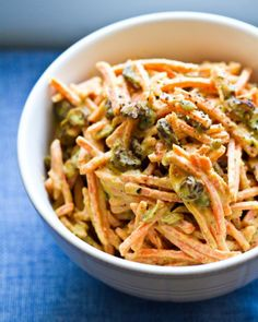 Carrol Tahini Slaw: 10 oz. Julienne Cut Carrots, 1 Cup Raisins, 1/4 Cup. Pumpkin Seeds, 1/3 Cup tahini, 1-2 Tbsp. Muchi Curry powder, 1/4 Cup lemon Juice, 2 Tbsp. Maple Syrup, 1/4 tsp. ground pepper. allow to marinate for several hours.
