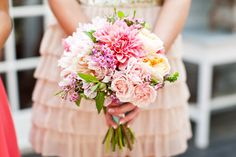 Bouquet composed of watermelon dahlias, white dahlias, peach garden roses, white dahlias, light pink garden roses, pink ranunculus, geranium foliage, tuberose, pink wax flower, soft pink spray roses, fresh mint, baby's breath, and zinnias. Created by April Peet of April Flowers