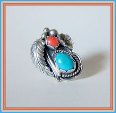 """This unusual and detailed Navajo Turquoise and Coral sterling ring was designed by the well respected silversmith/Artist from Winslow, Arizona region.  The ring is signed J. Nezzie (Jimmie Nezzie) and hallmark was first used in 1975. Reference to this designer can be found in """"Hallmarks of the Southwest"""" by Barton Wright."""