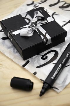Write on white tissue paper with a permanent marker, and use it as a ribbon for special presents.