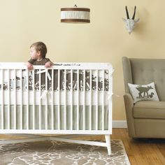 Clean and modern boy's nursery with animal accents