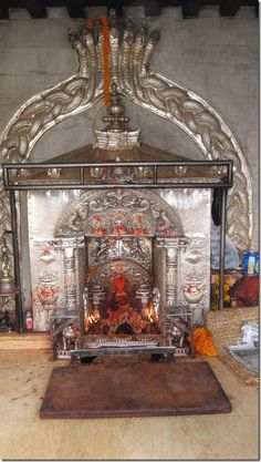 baglamukhi temple, Nepal - Bagulamukhi means the back side of Shiva. She dress herself in yellow garments and her skin is also yellowish in color, very soft, and smooth. Bagalamukhi is portrayed as an angry goddess who is pulling the tongue of an Asura by her left hand and her right hand ready to strike on the Asura's head.