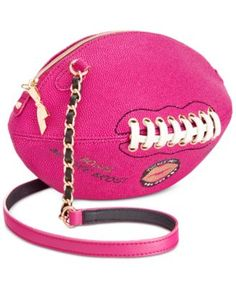 "Fashion's Mvp! Up your glam game instantly with Betsey Johnson's football bag featuring lace-up and chain-link details. | Faux leather | Imported | 11""W x 5""H x 5""D 