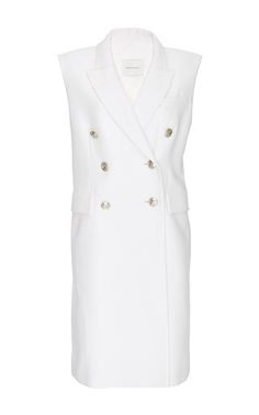 The understated sister line of storied French house Balmain, this diffusion label re-interprets the house's powerful feminine glamour with clean lines and timeless silhouettes. This **Pierre Balmain** knee-length vest features an extended length and double breasted button detailing.