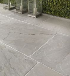 Salcombe Sandstone in a seasoned finish. Patio tiles with soft pale and grey tones.
