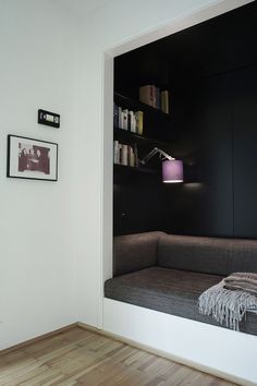 10 Reading Nooks Perfect For Curling Up In // Here's a dark nook that would be perfect for reading a book, then having a nap.
