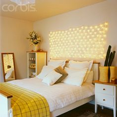 awesome string lights above bed. Good idea for the bedroom.