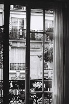 paris window -- love to stand on my balcony and see the apt. interiors across the way, when I'm in Paris.