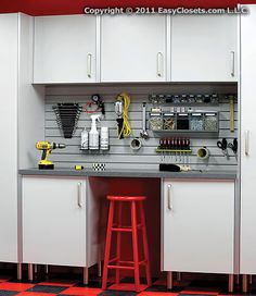 This workbench and store-wall combo neatly organizes tools, paints, and odds and ends that normally clutter a garage to create an efficient and clean workspace.