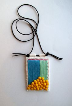 Colorblock embroidered pendant in mint blue by AnAstridEndeavor, $55.00