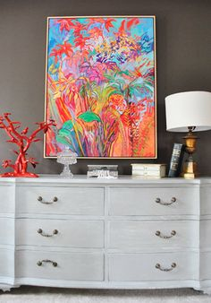 I am absolutely crazy about this bright floral artwork against this taupe gray wall with neutral white dresser! House Crashing: John And Sherry Plus 8 | Young House Love