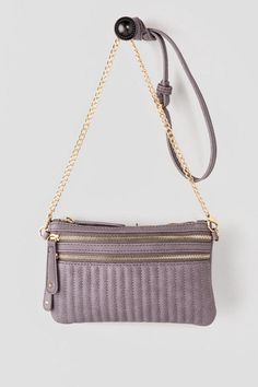 """Carry your essentials in style with the Hillsboro Zipper Crossbody. This faux leather bag features two zipper pockets across the front with vertical stitched details allover. Finished with an interior zipper pocket and an optional long strap. Pair with a crop top and sandals for the perfect look!<br><br>  -9"""" width x 6"""" height x 1"""" depth<br> -23"""" adjustable strap drop<br> -Imported<br>"""