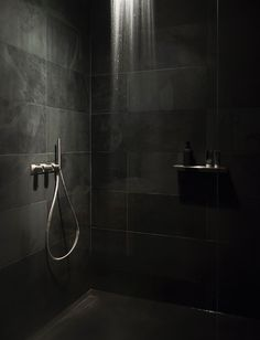 black calibrated slate, extra clear glass, CEA design faucets and accessories, chroma-therapy lighting shower-head.