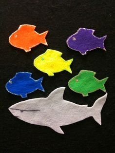 """Five Little Fishies Swimming in the Sea""  Five little fishies swimming in the sea,  Teasing Mr. Shark,  ""You can't catch me!""  When along comes Mr. Shark  Aaaaaaannnnnndddddd SNAP!"