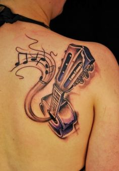 Guitar tattoo designs can exbhits love towards music. In this article you can find 10 amazing guitar tattoo designs which are definitely inspire you. Acoustic Guitar Tattoo, Guitar Tattoo Design, Music Tattoo Designs, Music Tattoos, Tattoo Designs Men, Body Art Tattoos, New Tattoos, Cool Tattoos, Ukulele Tattoo