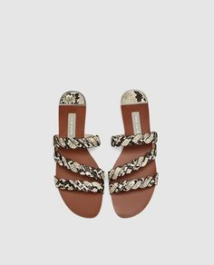 SANDALS WITH BRAIDED ANIMAL PRINT STRAPS