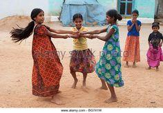 Indian girls swinging around in their village - Stock Image
