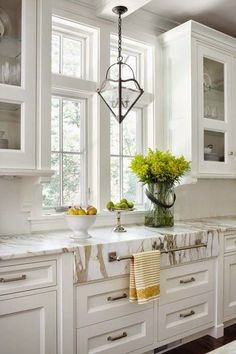 """""""Calacatta Gold"""" marble covers the kitchen countertops and is simply gorgeous."""