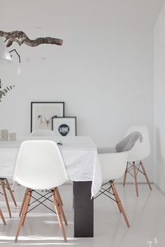 Eames Chairs, White seat with wooden legs.