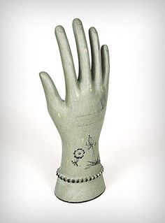 I love these victorian-esque disembodied hands to hold jewelry. This one is a little ghostly, even!