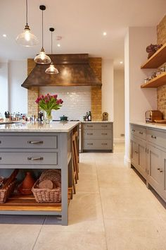 Unique Rustic Vent Hood in a Grey and Brick Kitchen Kitchen Design - Kitchen Remodel - Kitchen Ideas - Kitchen Organization - Grey Kitchen Cabinets - Renovation Ideas - Kitchen Renovation - Brick Backsplash Farmhouse Style Kitchen, Home Decor Kitchen, Country Kitchen, New Kitchen, Home Kitchens, Kitchen Rustic, Kitchen Ideas, Closed Kitchen, Industrial Style Kitchen