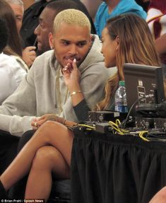 Loyal: Chris Brown was seen getting affectionate with his girlfriend Karrueche Tran on Wednesday, as they watched the US take on the Dominican Republic in a basketball game at New York City's Madison Square Garden