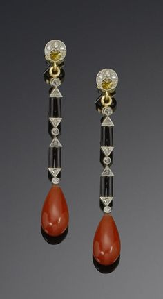 A pair of art deco diamond, enamel and coral pendent earrings, circa 1925  Each rose-cut diamond crescent suspending articulated black enamel and rose-cut diamond columns, terminating with a coral drop, length 5.5cm.