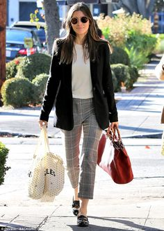 Simply chic: Jessica Biel looked polished-yet-practical in a basic cotton tee teamed with ...