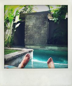 ENTRY - stone wall, covered, the pivot door, stone steps, stone planter, dip'n pool with stone coping. Elysian Hotel, Seminyak,Bali.