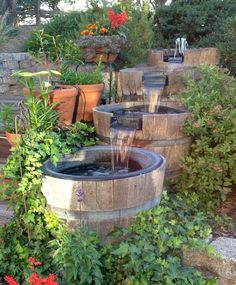 Backyard waterfall built from wine barrels!