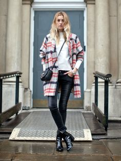 Camille Charrière with a checkered coat and patent leather boots, London