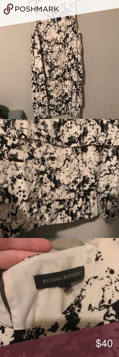 Banana Republic Black Splatter Tiered Dress Banana Republic Cream and Black Splatter Tiered Dress - Size 14. Excellent Used Condition.  Pervious owner was my very meticulous mother, so it's basically perfect 🤣 Only flaw is that she ripped off the size tag, but I posted a photo of the size 14 labeled on the tag inside the dress.  The splatter is beautiful and the tiered effect is really gorgeous. Banana Republic Dresses Midi