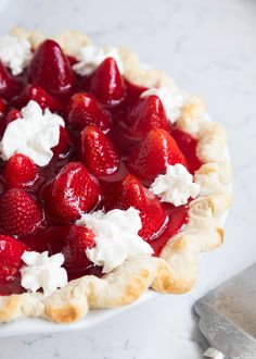 This homemade Fresh Strawberry Pie is made with a flaky crust, cheesecake filling and bursting with fresh strawberries. One of our favorite Spring desserts!