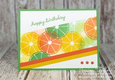Ahhh… the fruit slices on this card are as refreshing as a summer breeze. If you're ready to try something new on your cards, try adding your elements at an angle! Paper Sizes: Cucumber Crush card base: 5-1/2″ x 8-1/2″ folded in half Whisper White: 4″ x 5-1/4″ Fruit Slice Strip: 2″ Wide Tangerine Tango & Crushed Curry Strips: 1/4″ wide The key is to add your angled elements to a base card stock first and the elements should be longer than the base. Once you've glued on your pieces, just…