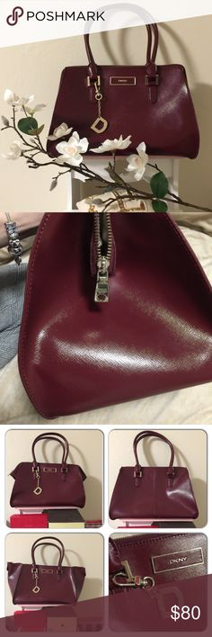 ❤️️DKNY Burgundy Large Satchel 👜❤️️ Pre-loved DKNY Luxury Saffiano Leather Large Bag.Used about 3times ,in like new conditions,just little bit pen marks inside but I think I can clean it out.It come with original addition strap for cross body wear.Sorry,can't remember where's I put the tag 🤔 DKNY Bags Satchels