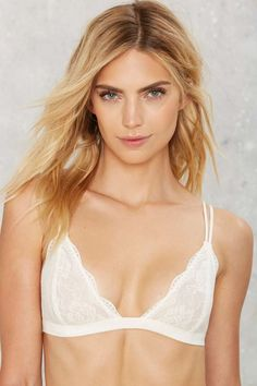 672665a693e27 Killer semi-sheer lace bralette featuring a floral lace detailing and  scalloped trim. White