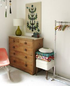 this arrangement is great for a small space, plus I am about to give in and buy a garment rack. maybe buy mismatched hangers