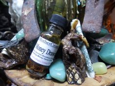 Money Drawing Oil  by MaidenMotherCrone on Etsy, $6.90